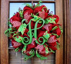 Rustic with a shot of whimsy! This fun design starts with a red paper mesh base (purchased at http://www.trendytree.com) and is decorated with splashes of red burlap ribbon, lime polka dot burlap ribbon, lime jute tubing (purchased at http://www.trendytree.com), lime window pane jute ribbon and to top it all off with style, a stunning vine monogram finished with a red and lime crackle. Merry Christmas! http://www.facebook.com/keenascreations  #trendytree #wreath