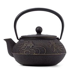 Handsome cast iron teapot features a Japanese goldfish or 'yamabuki,' whose color reflects the richness of pure gold.