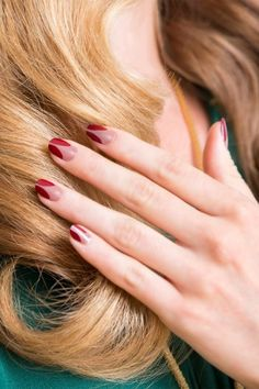 """It's a modern version of the 'V' French manicure, which is traditionally natural and white,"" says manicurist Dawn Sterling. ""I did a nude opaque and a deep red to add a bit of vamp and glam to this nail."" Tom Ford Nail Lacquer in Smoke Red, Dior Vernis Nail Lacquer in Trench"
