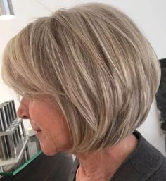 Dishwater Blonde Layered Bob Not quite ready to embrace your gray? No problem – the dirty blonde layered bob is one of those short haircuts for women over 60 that help you stay looking youthful and… Bob Hairstyles For Fine Hair, Cool Hairstyles, Formal Hairstyles, Chin Length Hairstyles, Hairstyles For Over 60, Wedding Hairstyles, Hairstyles Haircuts, Men's Hairstyle, Beach Hairstyles