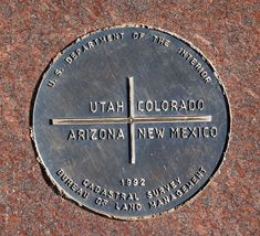 "A photo of the exact spot where Arizona, Colorado, New Mexico and Utah come together. This is called ""Four Corners."""