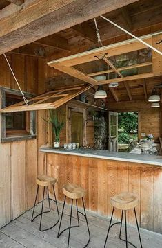 Start your outdoor kitchen design by making a list of must-have items. These could include a grill, sink, an island, gas cooktop, pizza oven, dining space or a bar. If you're worried about being budget-friendly, split your list into necessities and extras and make changes as your design and budget take shape.