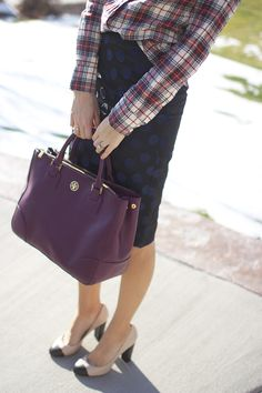 love the skirt and purse....looks way to mismatched though!! :)