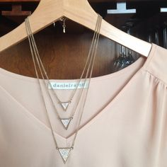 Express 3 layer necklace Express three layer pyramid necklace. Gold with pave diamanté on surface. Not real gold or real diamonds. Daniel Rainn top not included. No trades. Express Jewelry Necklaces