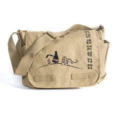 Vintage Canvas Outback Messenger Bag in khaki with screen printed logo on front  Heavyweight washed canvas  Large main compartment, zipper pouch ...