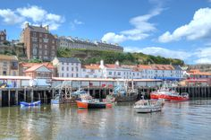 The fish market at Whitby, North Yorkshire. Although Whitby still has a small fishing fleet, it now earns most of its income via tourism. Click through to see more wonderful photographs by Baz Richardson.