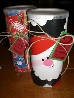 """These are Crystal Light containers. I covered them with scraps of Christmas wrapping paper and filled  them with something tasty for all my co-workers. Make a handmade tag and use whatever """"tie"""" you want..."""