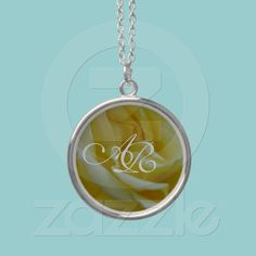 Monogram On Rose Necklace  A beautiful yellow rose is the background for a nice and elegant white monogram.