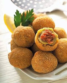 Olive all'ascolana - Italian region of Marche (Ascoli Piceno); Ingredients: stuffed olives, beef, pork, chicken, eggs, onion, carrot, celery, white wine, salt, cloves, pepper, bread crumbs, flour, extra virgin olive oil