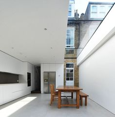 Modern kitchen w. skylight. Clever integration with older existing structure.