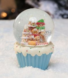 """Resin Gingerbread Water Globe by Accent Your Life. $16.99. Multi-colored. Globe top filled with water. A unique gift idea. 4""""L x 4""""W x 5.75""""H. What a magical holiday accent. Atop a cupcake base, this globe is full of smiling gingerbread people next to a festively decorated gingerbread house. Shake it up, and watch the enchanting snow fall over their little world. This water globe is perfect for yourself or as a special gift idea."""