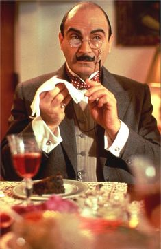 Hercule Poirot | For all his Continental culinary pride, he's a foodie and that shines through even in the fog of London. It's a cute and memorable moment that Suchet creates for viewers.