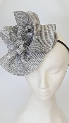 Check out this item in my Etsy shop https://www.etsy.com/il-en/listing/594699478/gray-silver-fascinator-hats-derby-hat