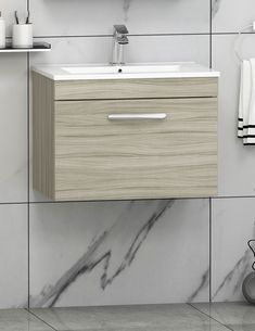 Beechwood oak storage cabinet unit is manufactured with 18mm Moisture-resistant MFC with Gloss White ceramic basin. This features a smooth soft-close drawer and chrome handle, that will add more value to this compact vanity unit. Enjoy!