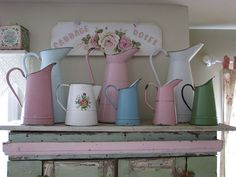I love these enamelware pitchers and how perfectly they are displayed with the cupboard.......
