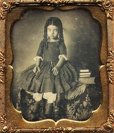 Daguerreotype image of a Little Girl sitting on a Table
