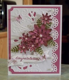This pretty card measures 5 1/2 X 4 1/4 and was made using various stamps, punches, dies & embossing folders. The butterflies are glitter embossed