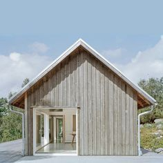 Summer house in Sweden by architect Mikael Bergquist with timber walls that will fade to grey