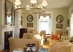 P. Allen Smith's front parlor (in summer) painted Benjamin Moore Nantucket Breeze--slipcovers provide a change of color to brighten the space from its winter tones as the seasons change