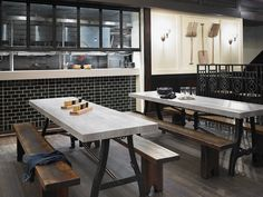 Formica® Laminate 6410 Weathered Beamwood provides the perfect rustic touch to the community tables in this brewery. Formica® Surfaces. For Real.™