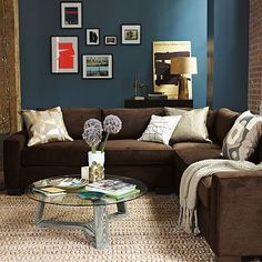 The Rich Blue And Cozy Brown Couch Despite Darker Colors Room Accents Keep It Light I Would LOVE This