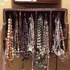 After buying a basket from Hobby Lobby I hung it on the wall and screwed cup hooks into it to hold jewelry.