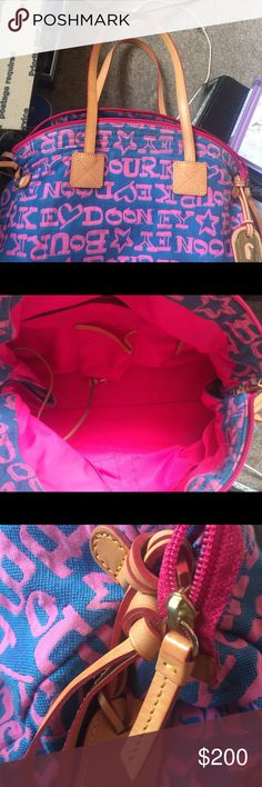 Dooney&Bourke Mint condition with leather tassels and strap beautiful blue and hot pink satin material inside mint condition Dooney & Bourke Bags Shoulder Bags