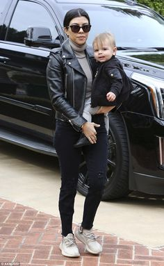 Fashionista: Kourtney Kardashian took son Mason out with her in Beverly Hills on Thursday rocking a black leather jacket and Yeezy Boosts