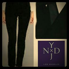 Listing NYDJ Black Pants These classic black pants are a,must-have for any wardrobe! They have a contrasting fabric stripe on the side of each pant leg. Pic 2 shows the contrast fabric...it is black, but a shade lighter (the flas from the camera makes it look gray). Straight leg. Feel free to ask additional questions before purchasing. NYDJ Pants Straight Leg