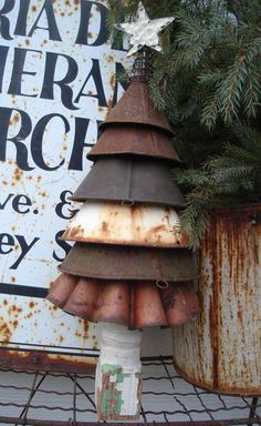 Use old rusty funnels to make a great rustic Christmas tree. You can also paint some funnels brown, then another color over the top and sand a few places so the brown shows underneath. Or you can rust some funnels yourself. I've use hydrogen peroxide to rust things and vinegar works as well. There are several more ways to rust things if you want to do some research.