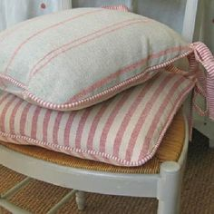 Susie Watson Designs Fabric Collection - Kitchen chair with neutral cushion with pink stripes and pink edging and ties, second cushion in larger pink and white stripes and ties.