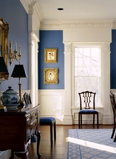 Blue and White Dining.  Love the crown molding, wainscot and the contrast of the blue against the white.