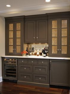 Love the dark paint color of this built in bar!