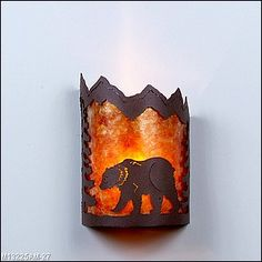 This Cascade Wall Sconce features an exclusive metal art design of a bear and spruce trees made of rounded mica under a steel frame. One lightbulb points upward. This rustic wall light will add rustic character to any log home, cabin or north woods, lodge-themed room. Available on CampFitters.com under Cabin Decor  Lighting  Sconces.