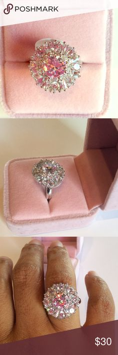 Bling Bling 925 Stamped CZ Statement Ring Wow this Sterling silver ring with Cubic zirconia is a stunner. You will be the envy ladies. This is a must have statement ring. Pink ring box for props only will not come with the ring when purchased. Jewelry Rings