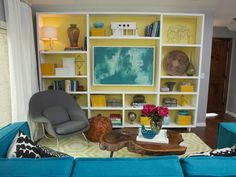 Custom shelving with pops of an inviting yellow-green shade adds both style and function to the room.
