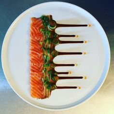 Cured salmon, salmon roe, in a fresh cucumber with micro leaves & a velvety spicy sauce Gourmet Recipes, Cooking Recipes, Gourmet Desserts, Plated Desserts, Gourmet Foods, Food Plating Techniques, Salmon Roe, Food Decoration, Chefs
