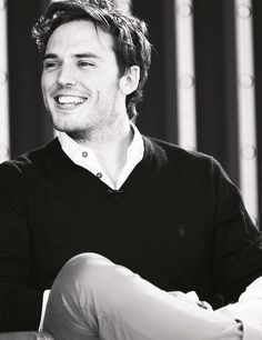 meet sam claflin he is finnick in the chasing fire o. my. god. he is beautiful