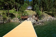 Lake Pend Oreille, Cape Horn, 200' frontage, main home: 3 bed, 1.75 bath, 2272 sq ft, guest home: 1 bed, 0.75 bath, 352 sq ft, 4 total parcels for 0.872 acre, 2 car attached garage plus plenty of parking, lawn and garden areas, multiple decks, jetted tub in master bedroom, stunning views, covered deck on the water, large dock, breakwater, boat slip, shallow swimming area. Appraised in May 2014 - waterfront house for $600,000 and cabin with secondary lot for $210,000.