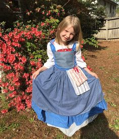 Here is the child size dress inspired by Belle from the new Beauty and the Beast coming out this year. It is made to order and includes: -skirt with attached slip -corset top -white top with separate white fichu -apron -the red and blue bags (functional) The bodice is lined. It ties on the inside and out. The white shirt is not lined and drawstrings around the neck. The cherry fabric is on the underside bottom part of the slip in case you would like to pin it up. The bloomers are listed…