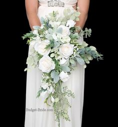 All white wedding flower bouquet with lots of greenery foliage silver dollar eucalyptus and lambs ear brides bouquet