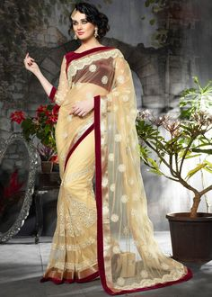 #Cream #net saree decorated with resham embroidery, stone, beads, lace and patch border work.