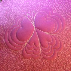 Another cute free motion quilted Love Butterfly surrounded with dense Stippling to make it puff! http://www.freemotionquilting.blogspot.com/2015/01/design-441-love-butterfly.html