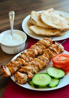 """Lebanese Shish Taouk - Dan said, """"you could make these once a week at least!"""". For marinade, added dashes of ground coriander, cubin, allspice, cardamom, cloves, cinnamon, paprika, and nutmeg in lieu of baharat. Served with chopped tomato, cucumber, and thinly sliced red onion that marinated in lemon juice for an hour."""