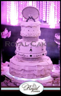 - Marry me! The perfect engagement cake, designed in ruffles, chandelier crystals and our signature ring topper! www.RoyalCakesLA.com