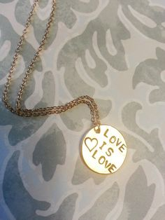 """$30----5/8"""" 14k gold filled hand stamped """"LOVE IS LOVE"""" pendant with <3 and 18"""" gold filled chain and findings celebrating the historic Supreme Court ruling removing DOMA and Proposition 8 that took place on June 26, 2013!! #jewelry #goldfilled #gold #sterlingsilver #wedding #bridal #bridesmaids #gift #love #heart #happy #necklace #handmade #handstamped #hand #stamped #custom #doll #loveislove #doma #prop8"""