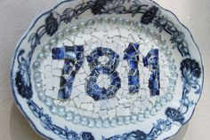 Want to add some crafty curb appeal? Use an antique platter as your base and stencil on your house numbers. Then fill them in with darker tiles using hot glue. If your china dishes are all patterned, flip them over and use white backs for the background.  Learn more at L'Von Qualls' Pinterest.   More: 12 DIY House Number Displays That Will Instantly Up Your Curb Appeal   - CountryLiving.com