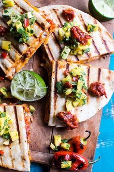 Treating the family to these delicious fiesta chicken quesadillas with chipotle relish and mango salsa.