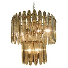 An Italian Midcentury Crystal and Brass Chandelier by Gaetano Sciolari