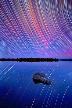 Captured using a long exposure, star trails show up as the Earth rotates, giving the impression that the stars are moving across the sky.